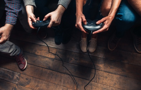 People play video game. Tension and competition.